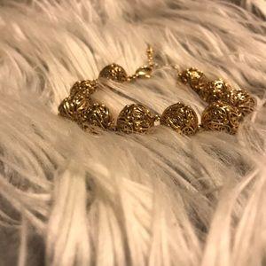 Gold hollow ball bracelet